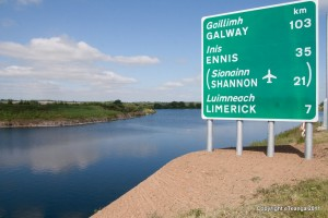English and Irish signs in County Clare. Irish Gaelic road signs. Ireland travel tips | Ireland vacations | IrelandFamilyVacations.com
