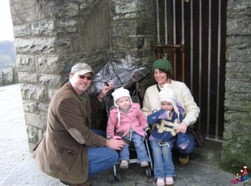 A Cold, Wet Day at the Cliffs of Moher, Ireland. Our typical Ireland vacation clothing: jackets, sweaters, and hats!