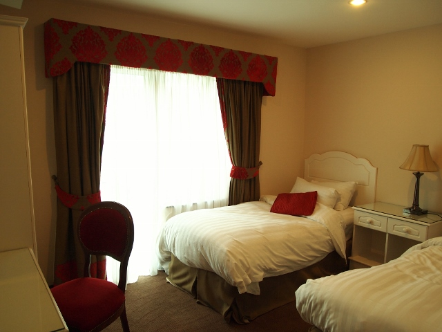 Twin beds in attached room at Fitzgerald's Woodlands House Hotel, Adare