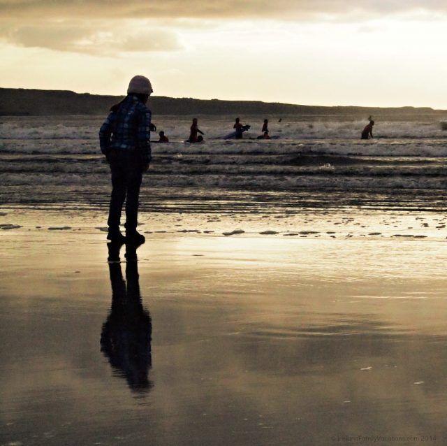 Watching surfers in Lahinch, Ireland.