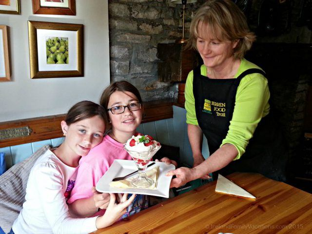 Mary delivers dessert at Kilshanny House. Burren Food Trail. Ireland vacation tips.