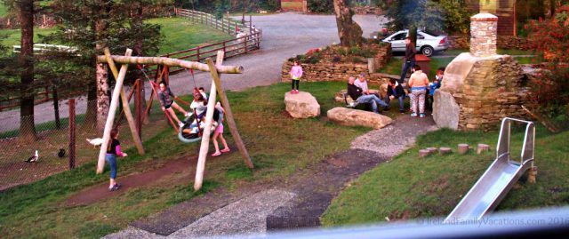 Campfire and play area at Top of the Rock Pod Pairc, West Cork, Ireland. Camping in Ireland | Ireland travel tips | Ireland vacation | IrelandFamilyVacations.com