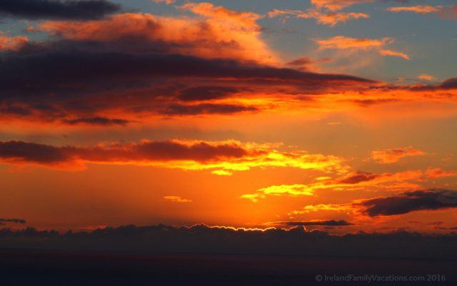 Fiery sunset over the Atlantic Ocean from the Cliffs of Moher. Ireland vacation tips | Ireland vacation | IrelandFamilyVacations.com