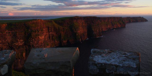 The Cliffs of Moher turn pink as the sun sets. Ireland travel tips | Ireland vacation | IrelandFamilyVacations.com