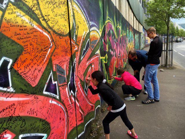 It's customary to leave your mark on a Belfast Peace Wall. Ireland travel tips | Ireland vacation | IrelandFamilyVacations.com