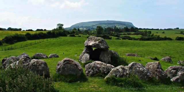 Queen Maeve's tomb atop Knocknarea beyond Carrowmore Megalithic Cemetery. Ireland travel tips | Ireland vacation | IrelandFamilyVacations.com