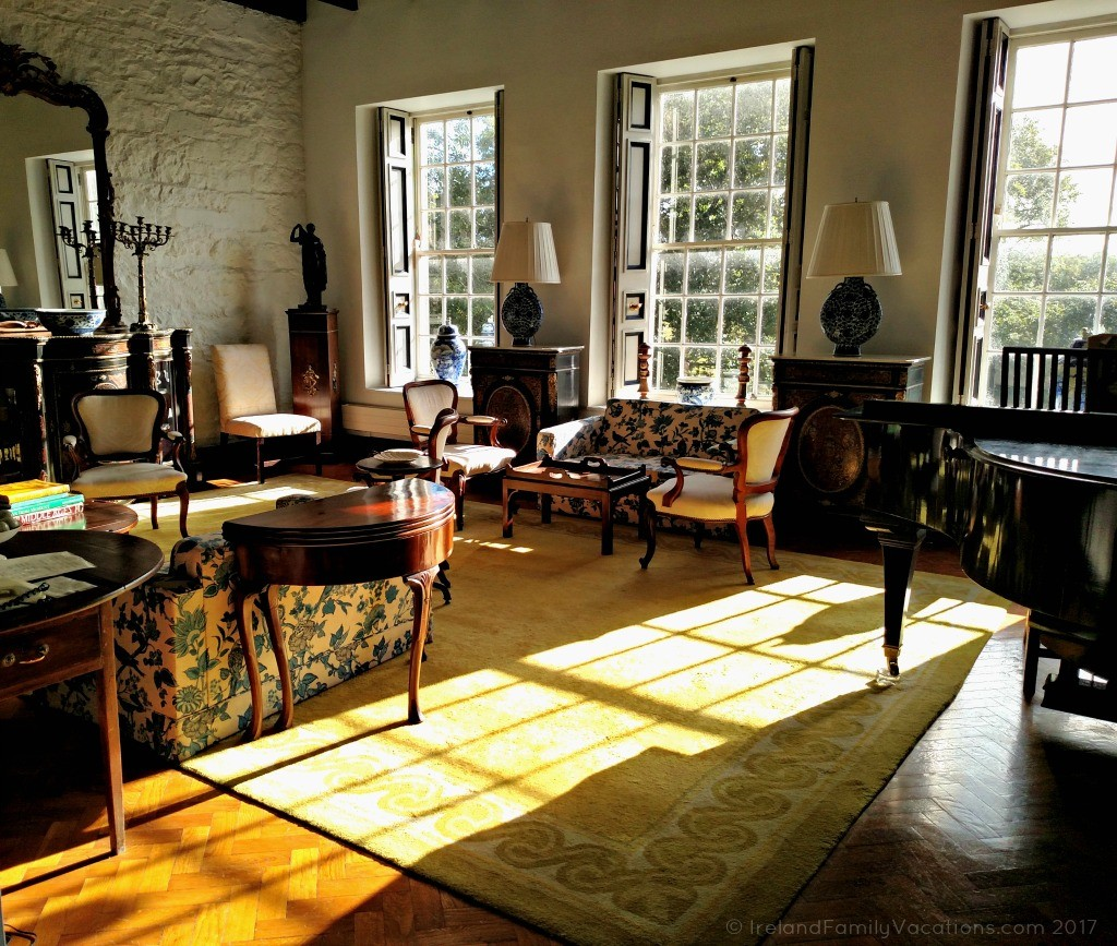 Afternoon sun slants into the sitting room at Knappogue Castle