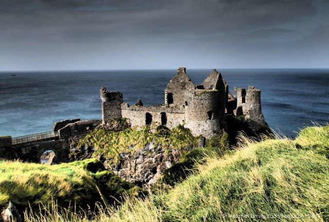 Dramatic Dunluce Castle along Northern Ireland's Causeway Coastal Route. Ireland travel tips | Ireland vacation | IrelandFamilyVacations.com