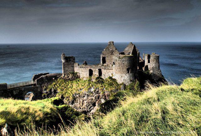 Dramatic Dunluce Castle along Northern Ireland's Causeway Coastal Route. Ireland travel tips | Ireland vacation | IrelandFamilyVacations.com