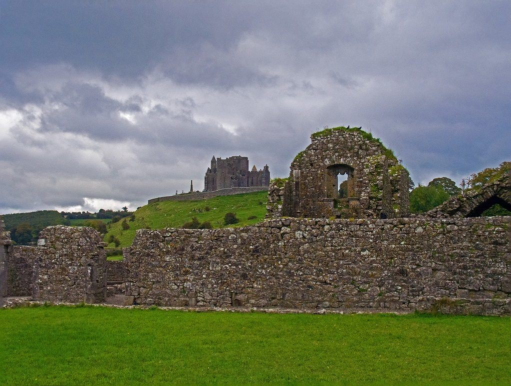 Ruins of Hore Abbey with Rock of Cashel in the Distance. Cashel, County Tipperary, Ireland