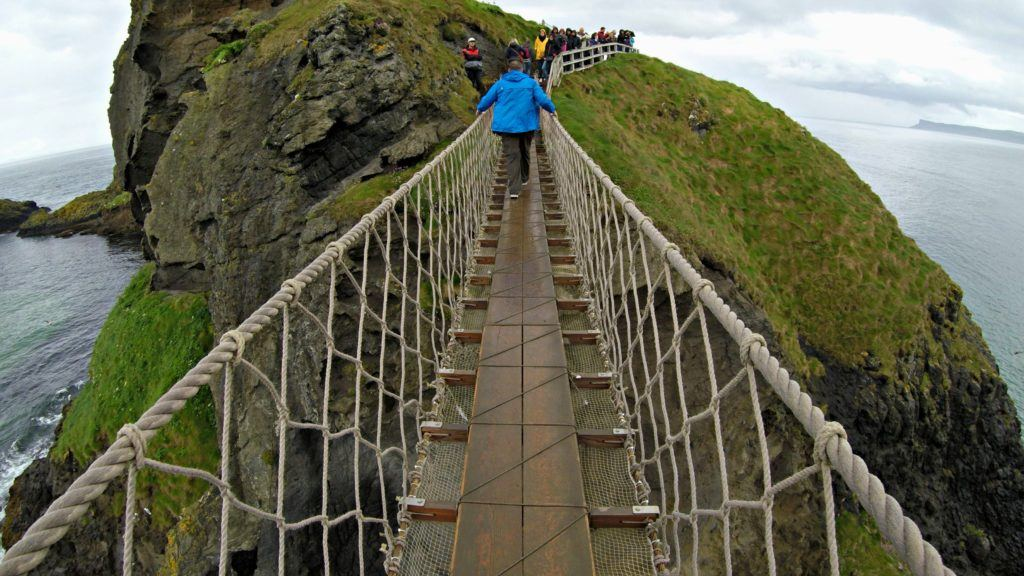 Crossing Carrick-a-Rede Rope Bridge, Causeway Coastal Route, Northern Ireland