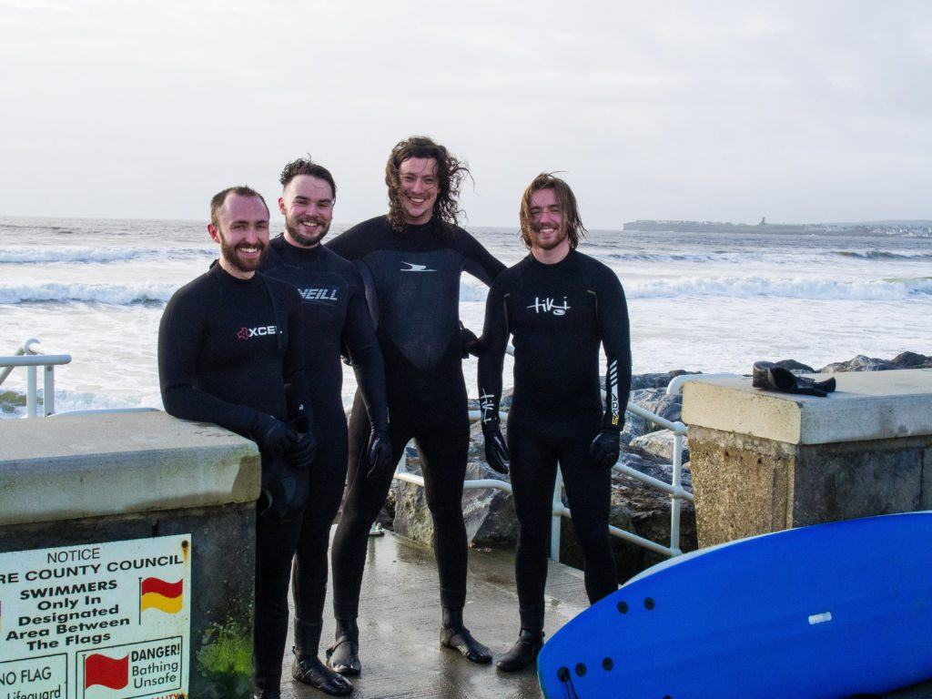 Surfers in Lahinch, County Clare, in January